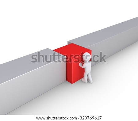 Person is putting a square block to connect the wall - stock photo
