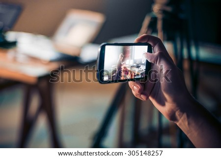 Person is taking photo with a smartphone. - stock photo