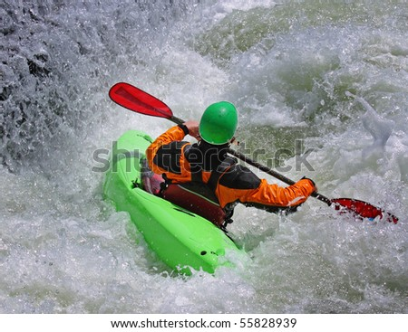 Person paddling their Kayak on whitewater rapids - stock photo