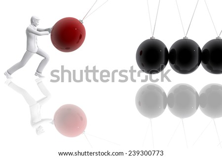 Person pushing a pendulum ball - stock photo