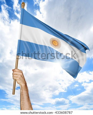 Person's hand holding the Argentine national flag and waving it in the sky, 3D rendering - stock photo