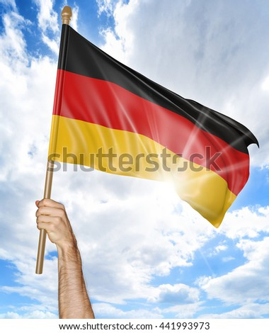 Person's hand holding the German national flag and waving it in the sky, 3D rendering - stock photo