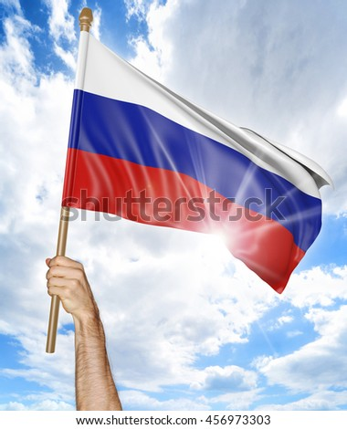 Person's hand holding the Russian national flag and waving it in the sky, 3D rendering - stock photo