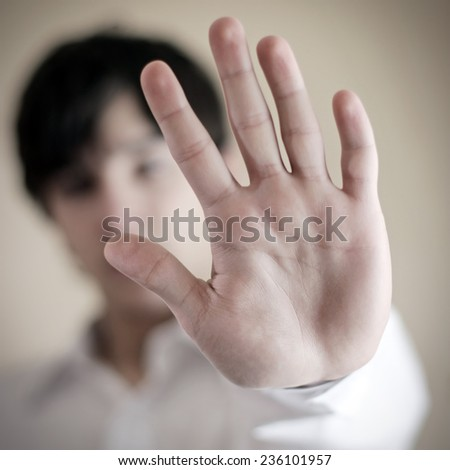 Person shows the Palm in the Home Interior - stock photo
