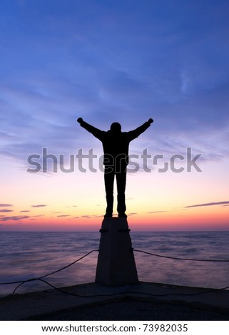 Person silhouette on background of the bright sundown. Abstract composition - stock photo