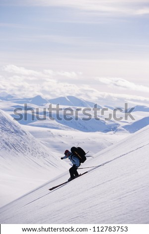 Person skiing down slope, side view - stock photo