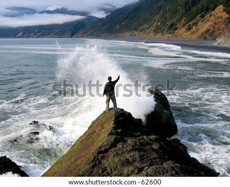 Person standing in ocean spray at Shelter Cove, CA - stock photo