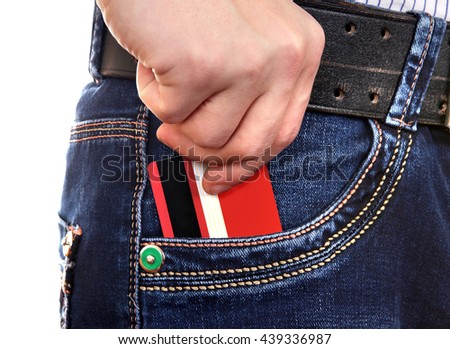 Person take up Credit Card from the Pocket of the Jeans - stock photo