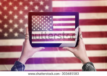 Person Taking Picture of United States of America Flag with Digital Tablet Computer, Vintage Tone Retro Effect - stock photo