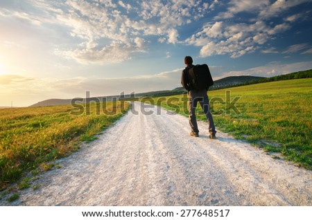 Person walk on the road lane. Traveling and tourism scene.  - stock photo