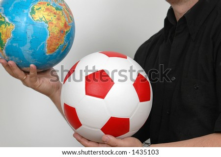 person with football and globe in hand. - stock photo