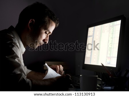 Person working late - stock photo