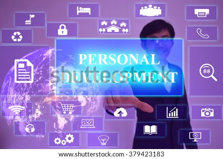 PERSONAL DEVELOPMENT concept  presented by  businessman touching on  virtual  screen ,image element furnished by NASA - stock photo