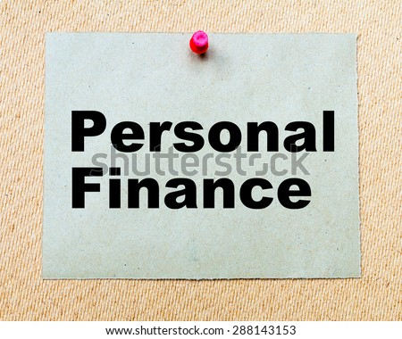 Personal Finance written on paper note pinned with red thumbtack on wooden board. Business conceptual Image - stock photo