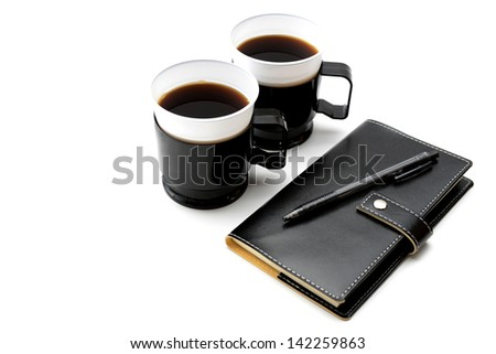 Personal organizer and cup of instant coffee for taking out - stock photo