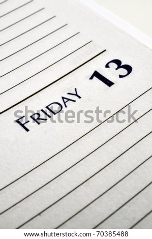 Personal planner opened to Friday the 13th. - stock photo