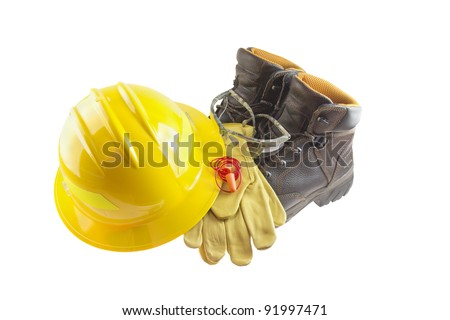 Personal protective equipment or PPE including leather boots, leather gloves, foam ear plugs, safety glasses, and yellow hard hat - stock photo