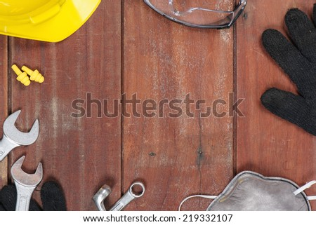 personal safety equipments on wooden plank with space in the center - stock photo