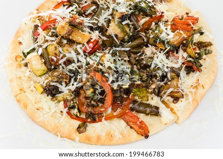 Personal sized sliced vegetable and cheese pizza. - stock photo