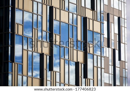 Perspective and underside angle view to textured background of modern glass building skyscrapers - stock photo