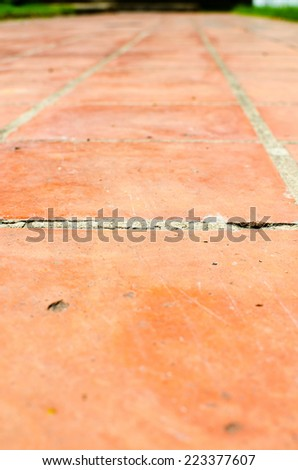 Perspective background : orange brick floor - stock photo