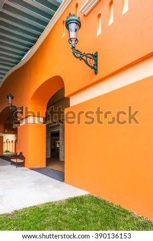 Perspective, fragment of the modern colorful tropical, colonial style building, lobby, deck, patio, promenade.  Exterior, interior design. - stock photo