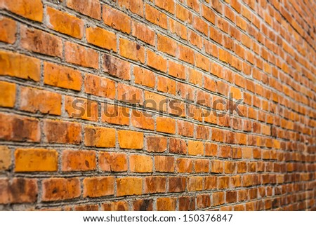 Perspective Of A Dirty Red Brick Wall. Selective Focus - stock photo