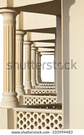 perspective of balconies and columns on white - stock photo
