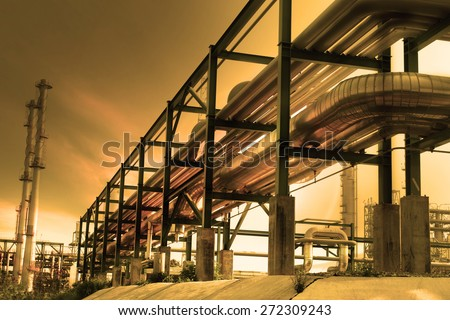 perspective of industry pipe line and beautiful dusky sky use as petrochemical industrial estate background - stock photo
