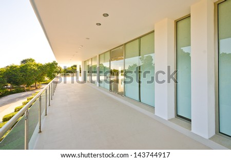 Perspective of the modern glass and steel balcony, deck, promenade railing. Exterior, interior design. - stock photo