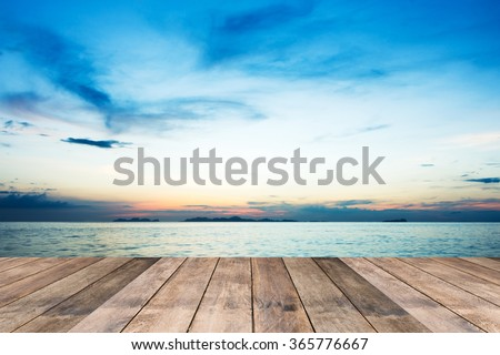 Perspective of wood terrace against beautiful seascape at sunset with free copy space use for background or backdrop. - stock photo