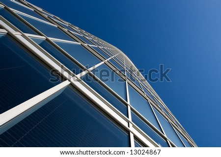 Perspective view at skyscraper windows from low angle - stock photo