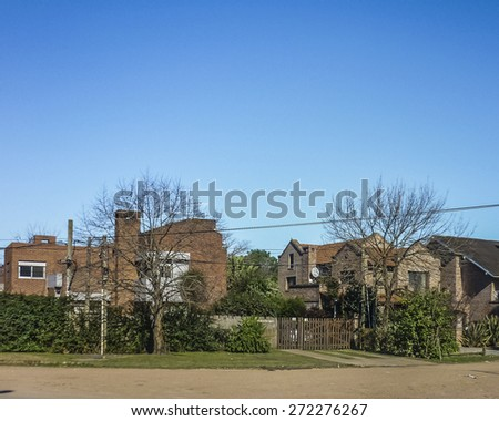 "Perspective view of a tranquil and nice street of ""Parque Miramar"" neighbourhood in the outsides of Montevideo in Uruguay - stock photo"