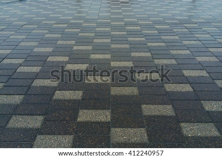Perspective View of Dark Brown and Black Brick Stone Pattern Street Road. Sidewalk, Pavement Texture Background for Interior Design - stock photo