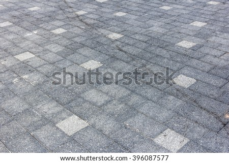 Perspective View of Monotone Gray dirty Brick Stone Street Road. Sidewalk, Pavement Texture Background - stock photo