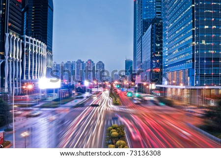perspective view to glass high-rise building skyscrapers at night - stock photo