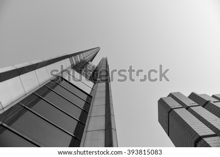 perspective wide angle view of glass high rise building Business concept of successful industrial architecture - stock photo