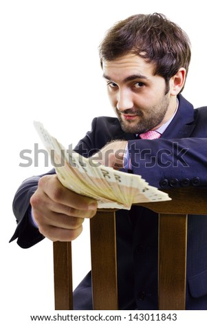 Persuasive handsome businessman with a lot of money, isolated on white. - stock photo