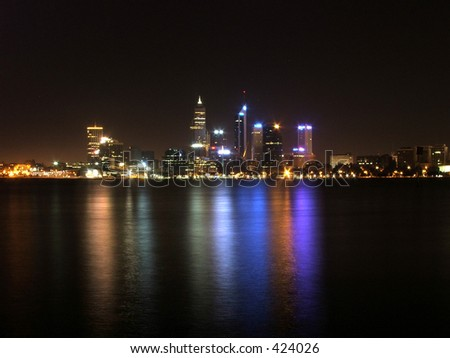 Perth city at night with reflections in the Swan River - stock photo