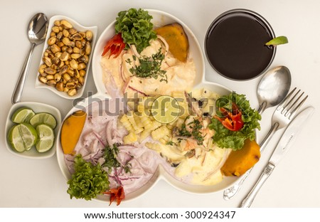 Peru Dish: 3 types of Cebiche (ceviche) with chicha drink, lemon and canchita (fried salty corn). - stock photo