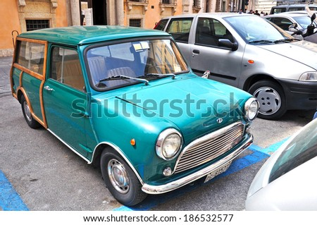 PERUGIA, ITALY- APRIL 22: Retro green automobile on April 22, 2011 in Perugia, Italy. Perugia hosts Jazz, Chocolate and Journalism festivals attracting many tourists each year. - stock photo