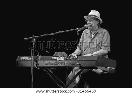 PERUGIA, ITALY - JULY 14 : Sergio Mendes plays keyboards on main stage at Umbria Jazz Festival - July 14, 2011 in Perugia, Italy - stock photo