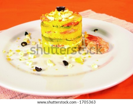 Peruvian causa limena dish with potato, egg and shrimp - stock photo