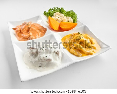 Peruvian gourmet cuisine: ceviche with tasty cream, called tiradito - stock photo