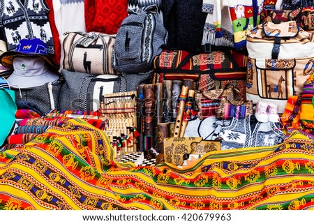 peruvian souvenirs and bags on the market - stock photo