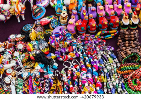 peruvian souvenirs and toys on the market - stock photo