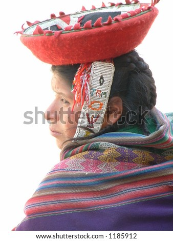 Peruvian woman in traditional dress - stock photo