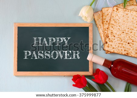 Pesah celebration concept (jewish Passover holiday) with wine and matza  - stock photo