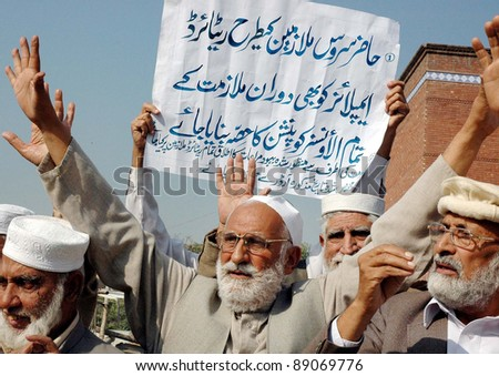 PESHAWAR, PAKISTAN - NOV 17: Pensioners are protesting in favor of their demands during a demonstration arranged by All Pakistan Pensioners Association (APPA) at Peshawar press club  . - stock photo