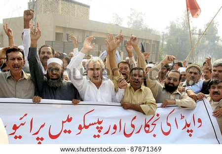 PESHAWAR, PAKISTAN - NOV 01: Supporters of WAPDA Hydro Electric Central Labor Union shout slogans in favor of their demands during protest demonstration on November 01, 2011in Peshawar, Pakistan. - stock photo